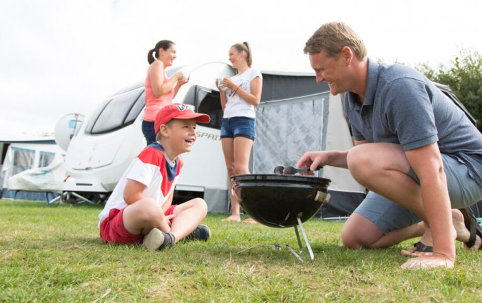 "For this tourism photography project Tony wanted to involve happy campers in the foreground and background. He found a lovely family of ""model campers"" on the site in Cornwall."