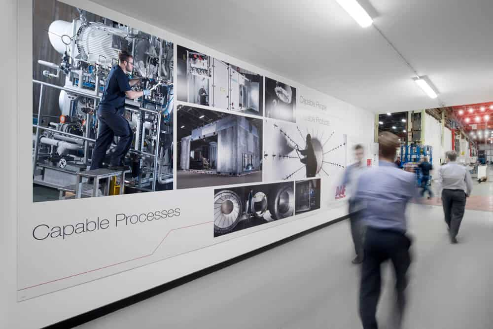 Large format prints of industrial photography were used in the factory.